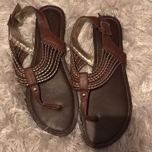 Brown and gold sandals.